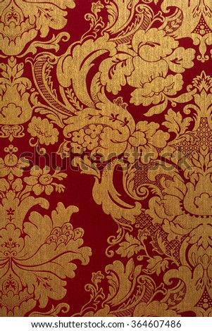 Floral gold and red pattern on seamless background. - stock photo