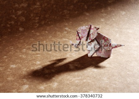 Floral origami elephant isolated on craft paper background. - stock photo