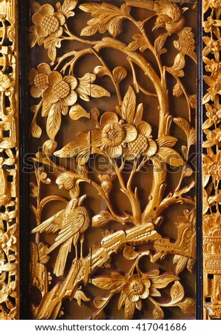 floral pattern of the teak wall - stock photo