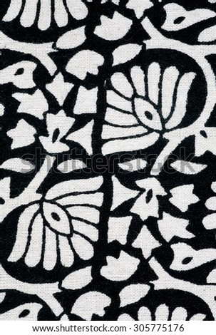 Floral pattern on black and white tablecloth in vintage hand-made style of stamping ink in India - stock photo