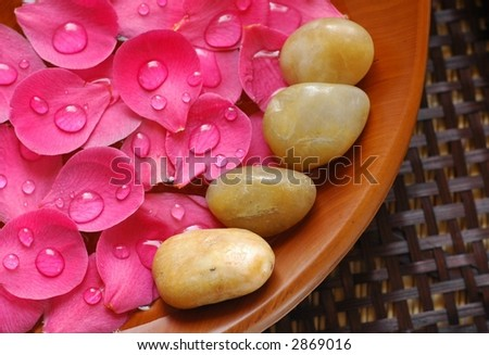 Floral scented water and therapy stones - stock photo