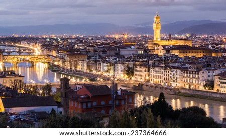 Florence at sunset, beautiful and romantic scene with city lights on.