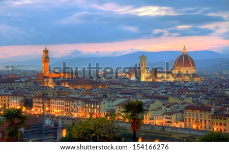 Florence city at dusk. Panoramic view to the river Arno, with Ponte Vecchio, Palazzo Vecchio and Cathedral of Santa Maria del Fiore (Duomo), Florence, Italy - stock photo