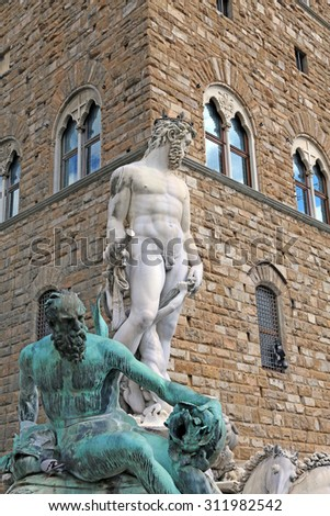 Florence historical fountain with the statue of Neptune in the main square