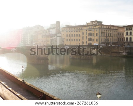 Florence, Italian medieval town - view of the city centre over the river Arno - stock photo