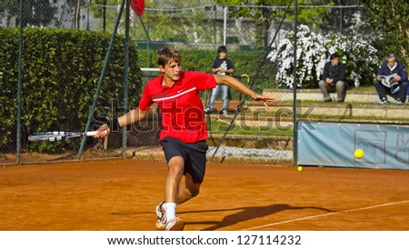 FLORENCE, ITALY - APRIL 08: Albert Alcaraz Ivorra plays a forehand at 37th City of Florence on April 08, 2012 in Florence, Italy - stock photo