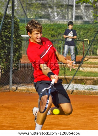 FLORENCE, ITALY - APRIL 08: Albert Alcaraz Ivorra plays a forehand at 37th City of Florence on April 08, 2012 in Florence, Italy. - stock photo
