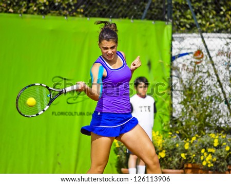 FLORENCE, ITALY - APRIL 09: Ana Konjuh plays a forehand at 37th City of Florence on April 09, 2012 in Florence, Italy - stock photo