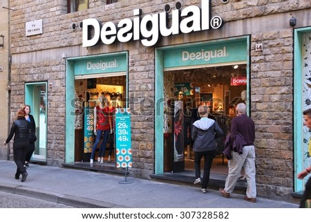 FLORENCE, ITALY - APRIL 30, 2015: Tourists visit Desigual fashion store in Florence. There are 200 Desigual brand stores. Desigual clothes are available in 72 countries.