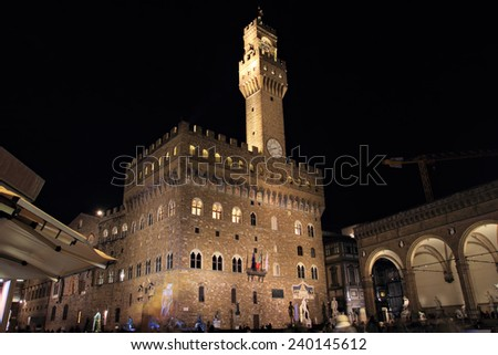 FLORENCE, ITALY - DECEMBER 7, 2014:  People in the famous Piazza della Signoria Square at night - stock photo