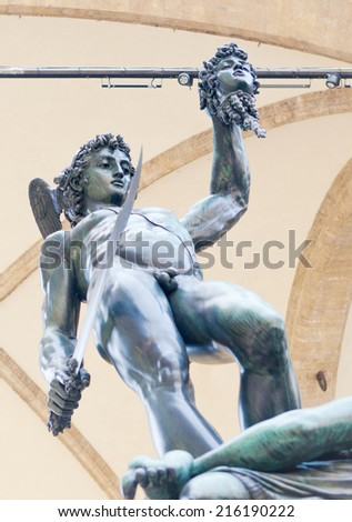 FLORENCE, ITALY - JUNE 11: Benvenuto Cellini bronze sculpture of Perseus with the head of Medusa at Piazza della Signoria in Florence, Italy on June 11, 2014.  - stock photo