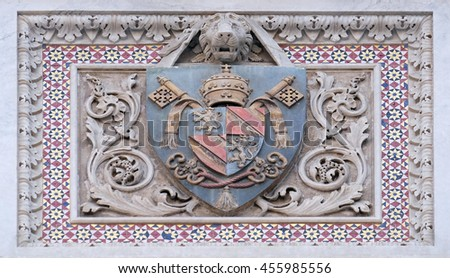 FLORENCE, ITALY - JUNE 05:  Coats of arms of prominent families that contributed to the facade., Portal of Cattedrale di Santa Maria del Fiore, Florence, Italy on June 05, 2015 - stock photo