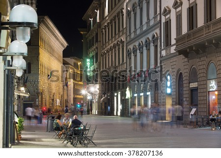 Florence, Italy-June 11, 2015. Late night street scene in the centre of Florence with tourists and locals on the streets and outdoor cafes, Florence, Italy