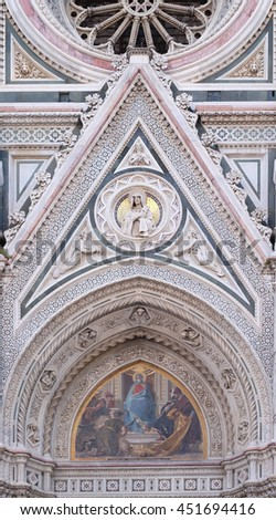 FLORENCE, ITALY - JUNE 05: Mary surrounded by Florentine Artists, Merchants and Humanists, Right Portal of Cattedrale di Santa Maria del Fiore, Florence, Italy on June 05, 2015 - stock photo