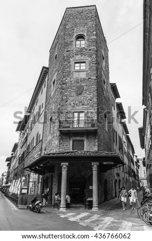 Florence, Italy - June 23, 2014: People on the streets of the ancient Italian city of Florence. Florence - the administrative center of the region of Tuscany . Black and white photography.