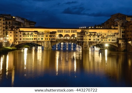 FLORENCE, ITALY - JUNE 9 2016: Ponte Vecchio is a stone arch bridge over the Arno River that was built in 1345 and 30 meters long. - stock photo