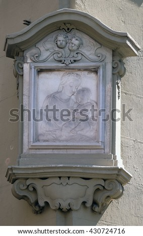 FLORENCE, ITALY - JUNE 05: Virgin Mary with baby Jesus, relief on the house facade in Florence, Italy, on June 05, 2015 - stock photo