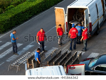 Florence, Italy - June 23, 2016: Workers work for the preparation of the fireworks for the pyrotechnic event to be held on the day of St. Giovanni Battista on June 24.