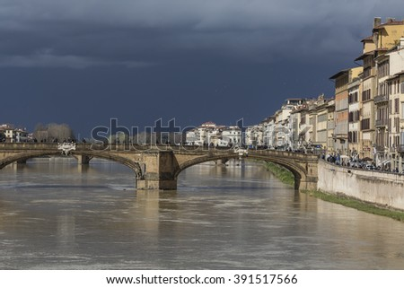 FLORENCE, ITALY - MARCH 07: Ponte Santa Trinita bridge over the Arno River shown on March 07, 2016 in Florence, Italy. The Ponte Santa Trinita is the oldest elliptic arch bridge in the world