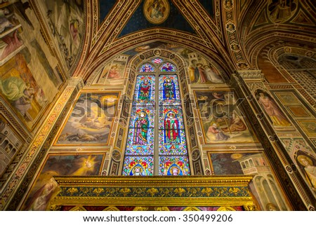 FLORENCE, ITALY - MARCH 14, 2015: Stained glass inside of the Basilica di Santa Maria del Fiore , Florence - Italy - stock photo
