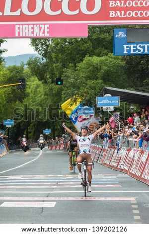 FLORENCE, ITALY - MAY 12: Carlos Beatancur, AG2R La Mondiale, second arrived on the finish line of the 9th stage of 2013 Giro d'Italia on May 12, 2013 in Florence, Italy - stock photo