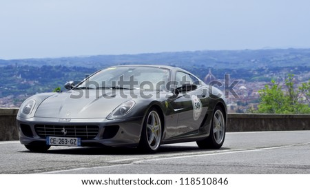 FLORENCE, ITALY - MAY 19: Ferrari 599 GTB Fiorano along Via Bolognese during the 1000 miles on May 19, 2012 in Florence, Italy