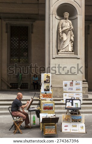 FLORENCE,ITALY-MAY 20 201 Many street artists selling arts for visitors whom walking through down town of Florence. Some in time may become classic. - stock photo