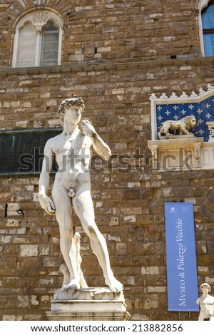 FLORENCE ITALY  20 MAY 2014 - The statue of David from Michelangelo at the Piazza Della Signoria where many visitors marvel the classic  art of Italian renaissance, in Florence. - stock photo