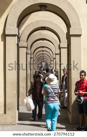 FLORENCE, ITALY - MAY 20, 2014: Tourists and locals alike visit historic center in Florence, Italy. Florence is home to some of the most famous works of art on earth. - stock photo