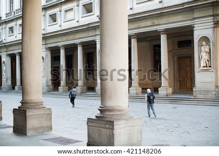 Florence, Italy-May 31, 2015. View of the Uffizi Gallery courtyard with tourist waling through. - stock photo