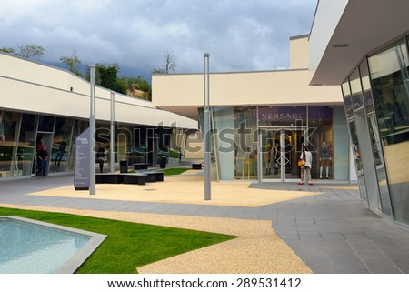 FLORENCE, ITALY - October 12, 2012: Tourists shop at Fashion Valley Outlet near Florence, Italy. Designer Outlets are located across Europe and offer discounts