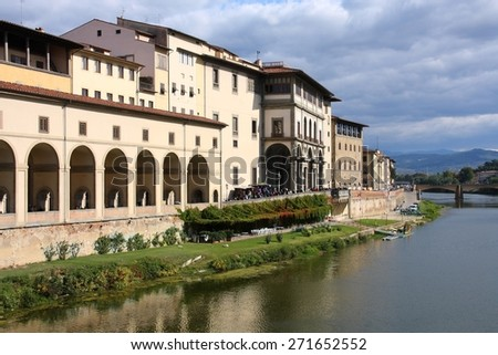 Florence, Italy - Old Town reflection in River Arno. Uffizi Gallery.
