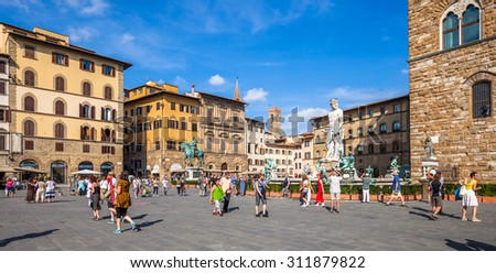 FLORENCE, ITALY - SEPTEMBER 9: Busy summer day at the popular Piazza della Signoria on September 9 2014 in Florence, Italy