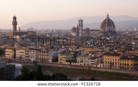 Florence Italy, skyline shot at dusk.  Featuring the Florence Cathedral (Basilica of Saint Mary of the Flower, ie the Duomo), the Arno River and the Palazzo Vecchio.