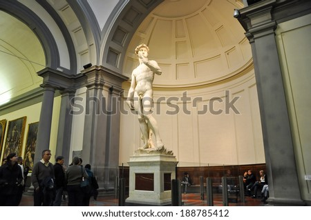 FLORENCE-NOVEMBER 10: Tourists look at David by Michelangelo on November 10,2010 in Academy of Fine Arts of Florence. Italy. - stock photo