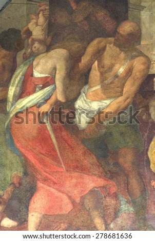 FLORENCE-OCTOBER 22: Mural in the hospital of Santa Maria Nuova. The hospital was founded in 1288 by Folco Portinari, the father of Beatrice beloved by Dante. Picture taken on 22 october, 2014. - stock photo