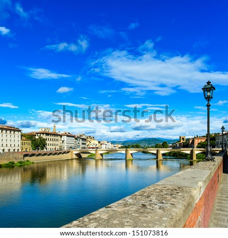 Florence or Firenze, Ponte alle Grazie bridge landmark on Arno river, sunset landscape with reflection. Tuscany, Italy. Long exposure. - stock photo