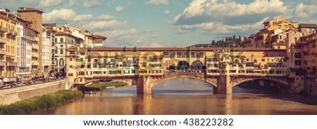 Florence panorama. Retro-styled panoramic view to ancient bridge Ponte Vecchio at river Arno in Firenze old town. Florence's famous touristic place of Tuscany region, Italy - stock photo