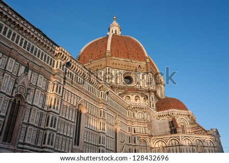Florence's cathedral stands tall over the city with its magnificent Renaissance dome designed by Filippo Brunelleschi. - stock photo