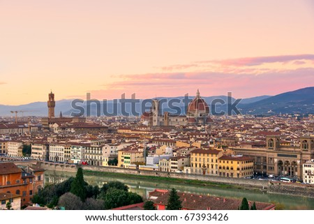 Florence, view of Duomo and Giotto's bell tower, Santa croce and palazzo signoria at sunset from Piazzale Michelangelo. - stock photo