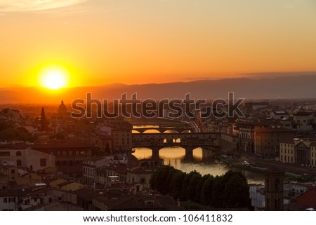 Florence with Arno River and Ponte Vecchio at sunset, Italy - stock photo