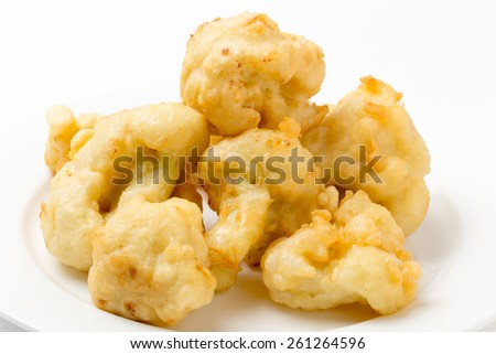 Florets of cauliflower parboiled then dipped in batter and deep fried