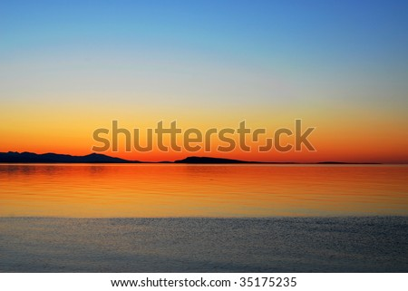 Florid seaside sunset at qualicum beach in vancouver island, british columbia, canada - stock photo