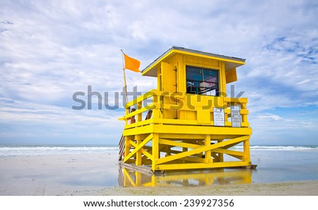 Florida beach yellow lifeguard house , Siesta Key  - stock photo