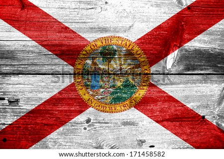 Florida Flag painted on old wood plank texture - stock photo