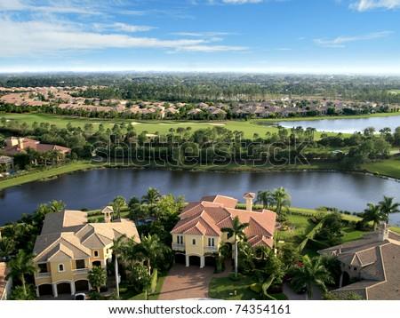Florida Neighborhood Overlooking Golf Course - stock photo