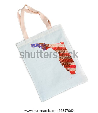 Florida state of the United States of America in grunge flag pattern over white shopping bag isolated on white background - stock photo