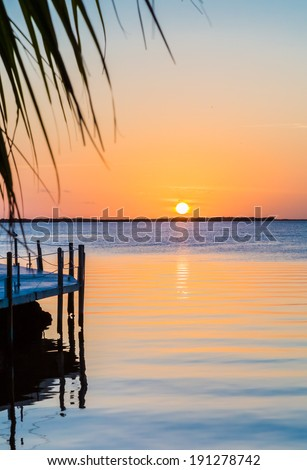 Florida sunset with gentle ripples in water - stock photo