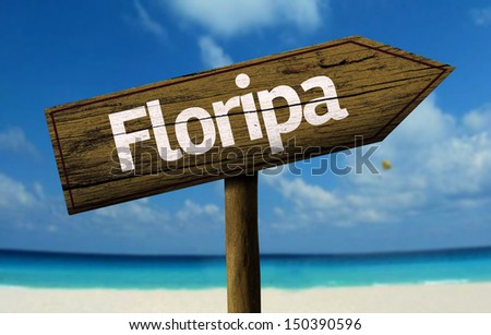 Floripa, Brazil wooden sign with a beach on background  - stock photo