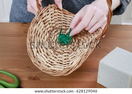 Florist at work: How to make autumn floral arrangement in wicker basket using dried flowers and other plants. Step by step, tutorial.